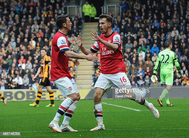 Aaron Ramsey celebrates scoring a goal for Arsenal with Mesut Ozil during the match between Hull City and Arsenal in the Barclays Premier League at...