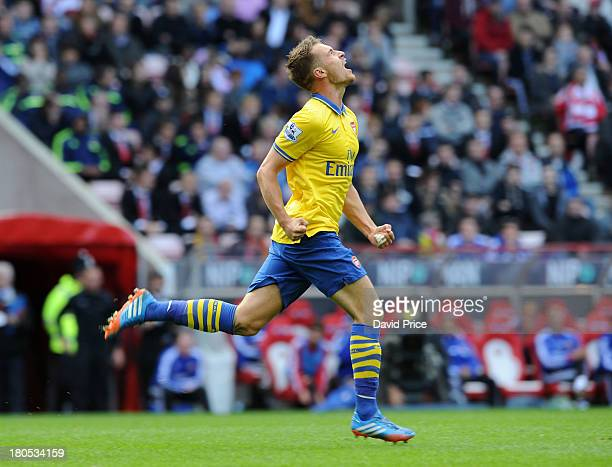 Aaron Ramsey celebrates scoring Arsenal's 2nd goal his 1st during the Barclays Premier League match between Sunderland and Arsenal at Stadium of...