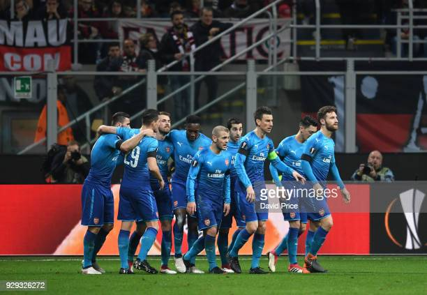 Aaron Ramsey celebrates scoring Arsenal's 2nd goal with his team mates during UEFA Europa League Round of 16 match between AC Milan and Arsenal at...