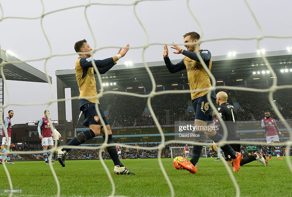 Aaron Ramsey celebrates scoring Arsenal's 2nd goal with Mesut Ozil during the Barclays Premier League match between Aston Villa and Arsenal on 13th December, 2015 in Birmingham, England.