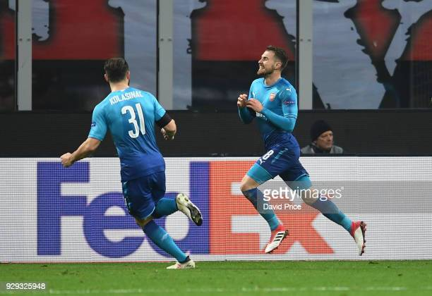 Aaron Ramsey celebrates scoring Arsenal's 2nd goal with Sead Kolasinac during UEFA Europa League Round of 16 match between AC Milan and Arsenal at...