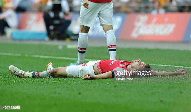 Aaron Ramsey celebrates scoring Arsenal's 3rd goal during the match between Arsenal and Hull City in the FA Cup Final at Wembley Stadium on May 17...