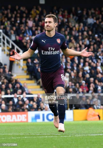 Aaron Ramsey celebrates scoring Arsenal's 3rd goal during the Premier League match between Fulham FC and Arsenal FC at Craven Cottage on October 7...