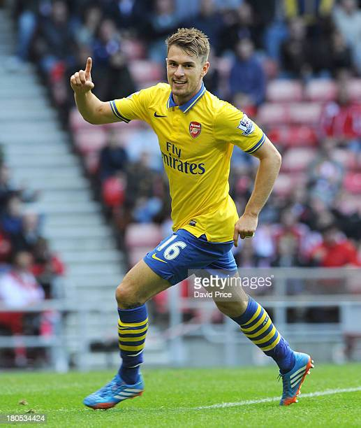 Aaron Ramsey celebrates scoring Arsenal's 3rd goal his 2nd during the Barclays Premier League match between Sunderland and Arsenal at Stadium of...