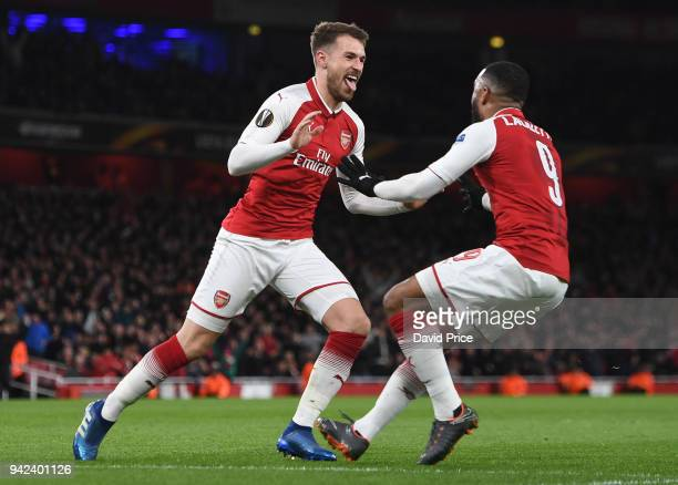 Aaron Ramsey celebrates scoring Arsenal's 3rd goal his 2nd with Alexandre Lacazette during the UEFA Europa League quarter final leg one match between...