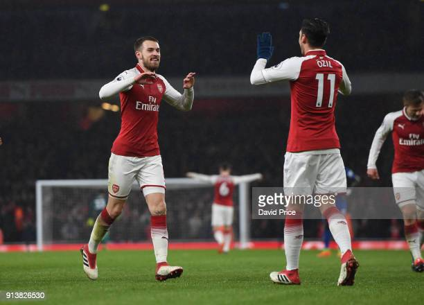 Aaron Ramsey celebrates scoring his 2nd goal Arsenal's 3rd with Mesut Ozil during the match the Premier League match between Arsenal and Everton at...