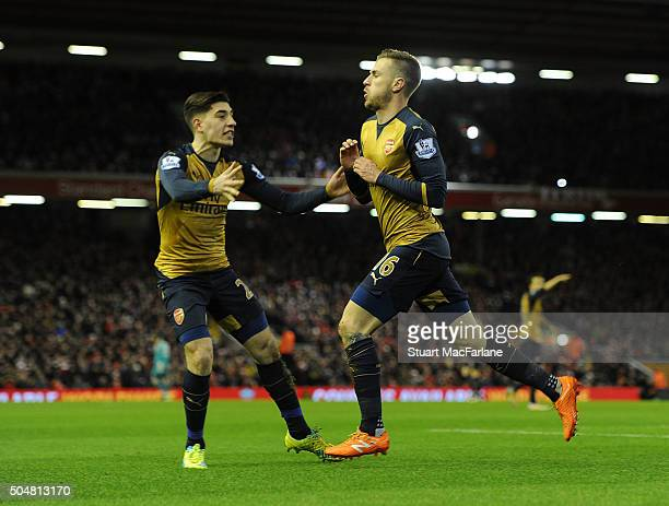 Aaron Ramsey celebrates scoring the 1st Arsenal goal with Hectro Bellerin during the Barclays Premier League match between Liverpool and Arsenal at...