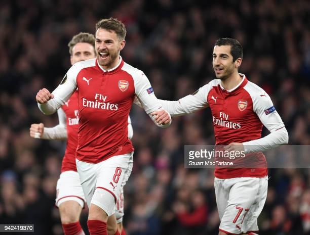 Aaron Ramsey celebrates scoring the 1st Arsenal goal with Henrikh Mkhitaryan during the UEFA Europa League quarter final leg one match between...