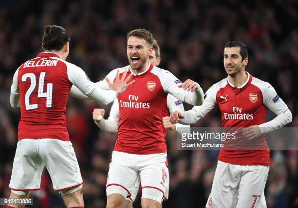Aaron Ramsey celebrates scoring the 1st Arsenal goal with Henrikh Mkhitaryan and Hector Bellerin during the UEFA Europa League quarter final leg one...