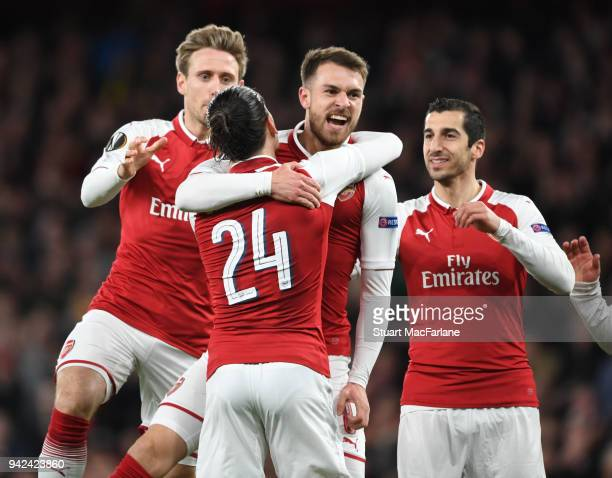 Aaron Ramsey celebrates scoring the 1st Arsenal goal with Nacho Monreal Hector Bellerin and Henrikh Mkhitaryan during the UEFA Europa League quarter...