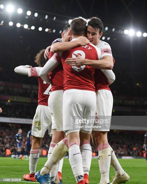 Aaron Ramsey celebrates scoring the 3rd Arsenal goal with Granit Xhaka and Laurent Koscielny during the Premier League match between Arsenal FC and...