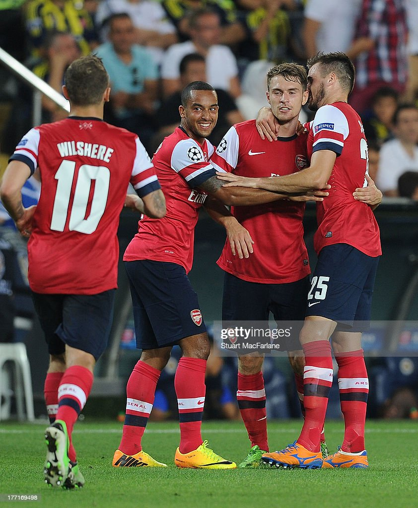 Aaron Ramsey celebrates scoring the 3rd Arsenal goal with (L-R) Jack Wilshere, Theo Walcott and Carl Jenkinson during the UEFA Champions League Play Off first leg match between Fenerbache SK and Arsenal FC at sukru Saracoglu Stadium on August 21, 2013 in Istanbul, Turkey.