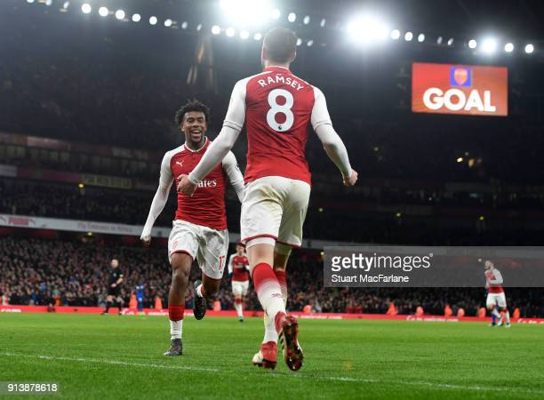 Aaron Ramsey celebrates scoring the 5th Arsenal goal with Alex Iwobi during the Premier League match between Arsenal and Everton at Emirates Stadium...