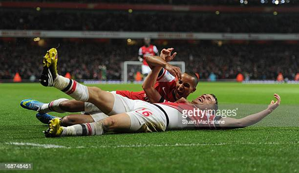 Aaron Ramsey celebrates scoring the the 4th Arsenal goal with Theo Walcott during the Barclays Premier League match between Arsenal and Everton at...