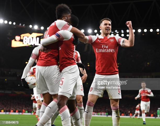 Aaron Ramsey celebrates the 1st Arsenal goal scored by PierreEmerick Aubameyang during the UEFA Europa League Round of 16 Second Leg match between...
