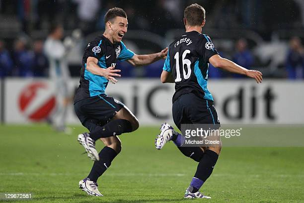 Aaron Ramsey celebrates with Laurent Koscielny of Arsenal after scoring an injury time winning goal during the UEFA Champions League Group F match...
