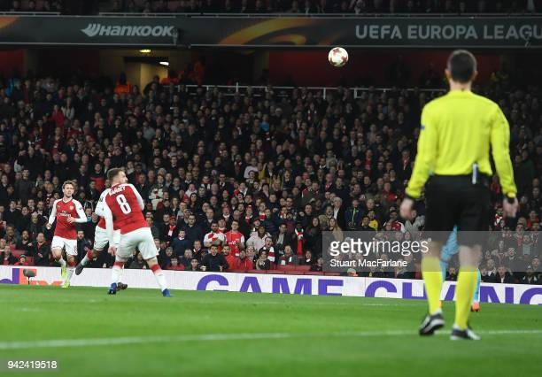 Aaron Ramsey chips the ball over CSKA goalkeeper Igor Akinfeev to score the 3rd Arsenal goal during the UEFA Europa League quarter final leg one...