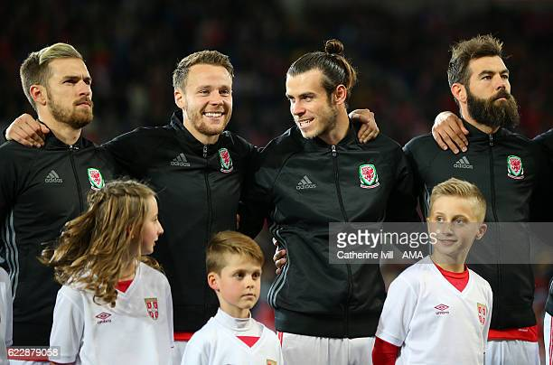Aaron Ramsey Chris Gunter Gareth Bale and Joe Ledley of Wales stand for the national anthem before the FIFA 2018 World Cup Qualifier between Wales...