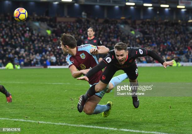 Aaron Ramsey is bundled to the ground by Burnley defender James Tarkowski for the Arsenal penalty during the Premier League match between Burnley and...