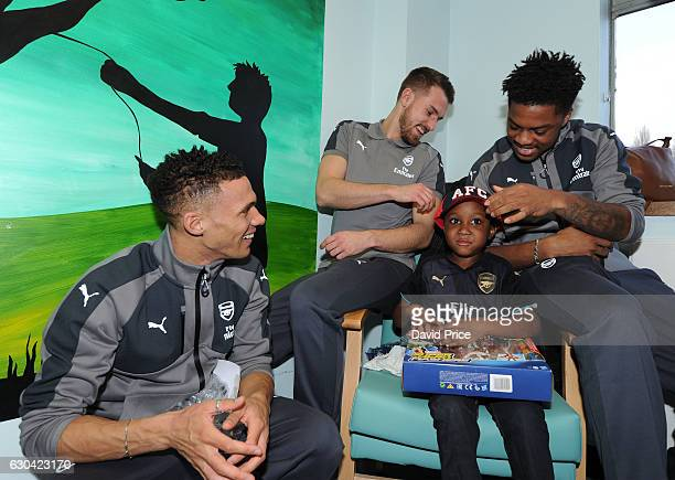 Aaron Ramsey, Kieran Gibbs and Chuba Akpom of Arsenal visit the patients on the childrens ward at Whittington Hospital on December 22, 2016 in...