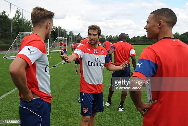 Aaron Ramsey Mathieu Flamini and Kieran Gibbs of Arsenal during a training session at London Colney on July 8 2014 in St Albans England