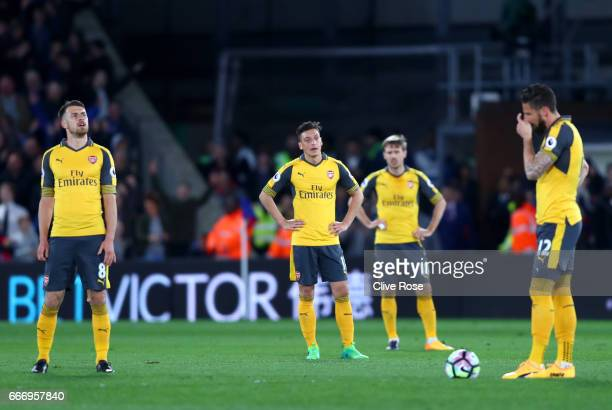 Aaron Ramsey Mesut Ozil Nacho Monreal and Olivier Giroud of Arsenal look dejected during the Premier League match between Crystal Palace and Arsenal...