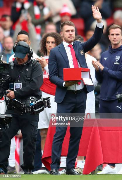 Aaron Ramsey of Arsenal acknowledges the crowd as he says farewell to the club and is presented with a gift following the Premier League match...