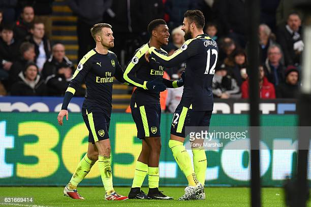 Aaron Ramsey of Arsenal Alex Iwobi of Arsenal and Olivier Giroud of Arsenal celebrate their second goal as Jack Cork of Swansea City scores a own...