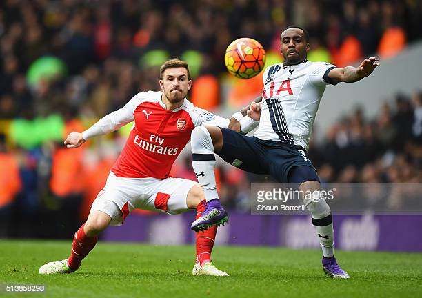 Aaron Ramsey of Arsenal and Danny Rose of Tottenham Hotspur battle for the ball during the Barclays Premier League match between Tottenham Hotspur...