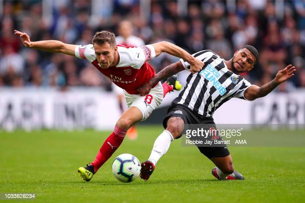 Aaron Ramsey of Arsenal and DeAndre Yedlin of Newcastle United during the Premier League match between Newcastle United and Arsenal FC at St. James...