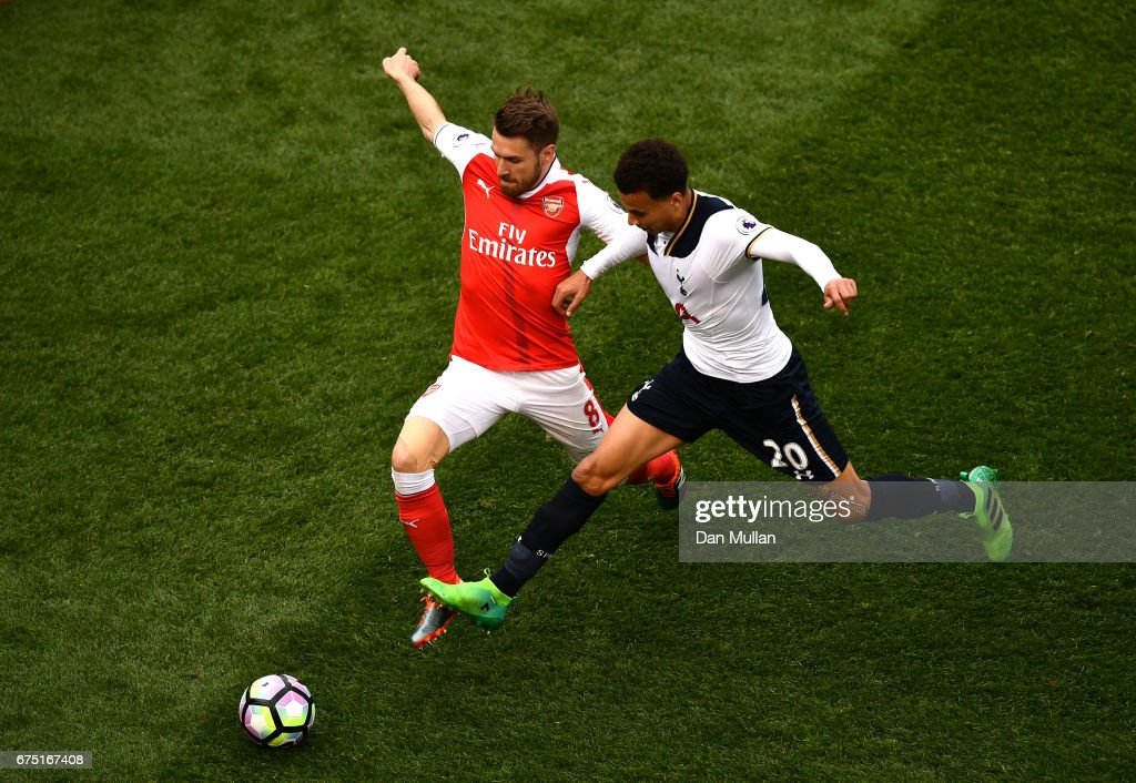 Aaron Ramsey of Arsenal and Dele Alli of Tottenham Hotspur battle for possession during the Premier League match between Tottenham Hotspur and Arsenal at White Hart Lane on April 30, 2017 in London, England.
