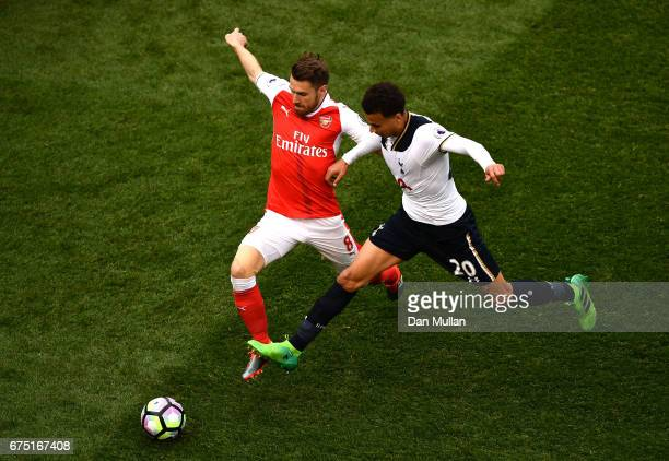 Aaron Ramsey of Arsenal and Dele Alli of Tottenham Hotspur battle for possession during the Premier League match between Tottenham Hotspur and...