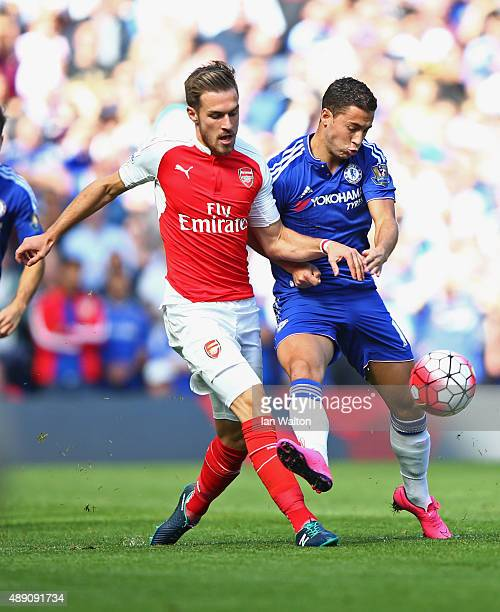 Aaron Ramsey of Arsenal and Eden Hazard of Chelsea compete for the ball during the Barclays Premier League match between Chelsea and Arsenal at...