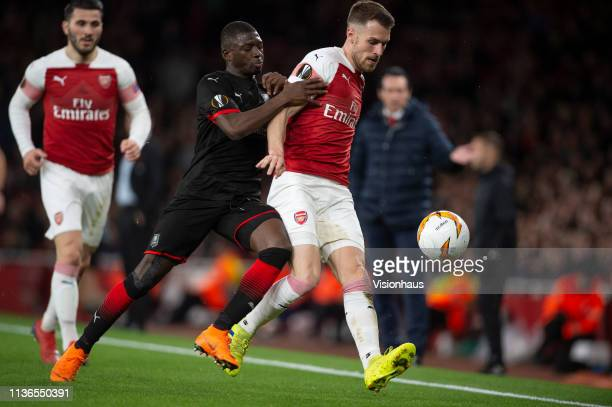 Aaron Ramsey of Arsenal and Hamari Traoré of Stade Rennais during the UEFA Europa League Round of 16 Second Leg match between Arsenal and Stade...