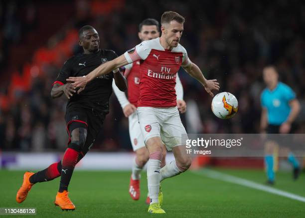 Aaron Ramsey of Arsenal and Hamary Traore of Stade Rennes battle for the ball during the UEFA Europa League Round of 16 Second Leg match between...