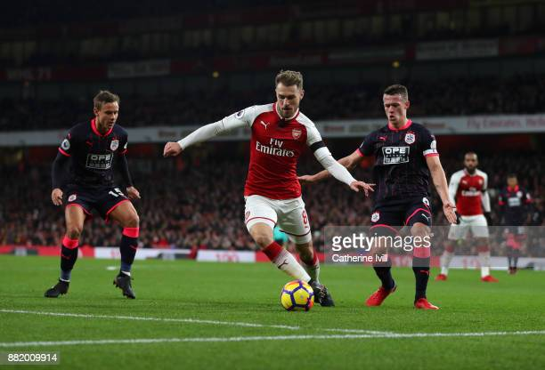 Aaron Ramsey of Arsenal and Jonathan Hogg of Huddersfield Town during the Premier League match between Arsenal and Huddersfield Town at Emirates...