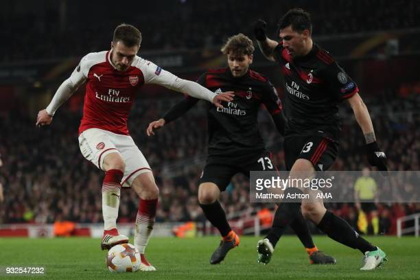Aaron Ramsey of Arsenal and Manuel Locatelli of AC Milan and Riccardo Montolivo of AC Milan during the UEFA Europa League Round of 16 Second Leg...