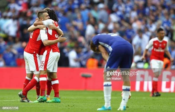 Aaron Ramsey of Arsenal and Mohamed Elneny of Arsenal embrace after The Emirates FA Cup Final between Arsenal and Chelsea at Wembley Stadium on May...