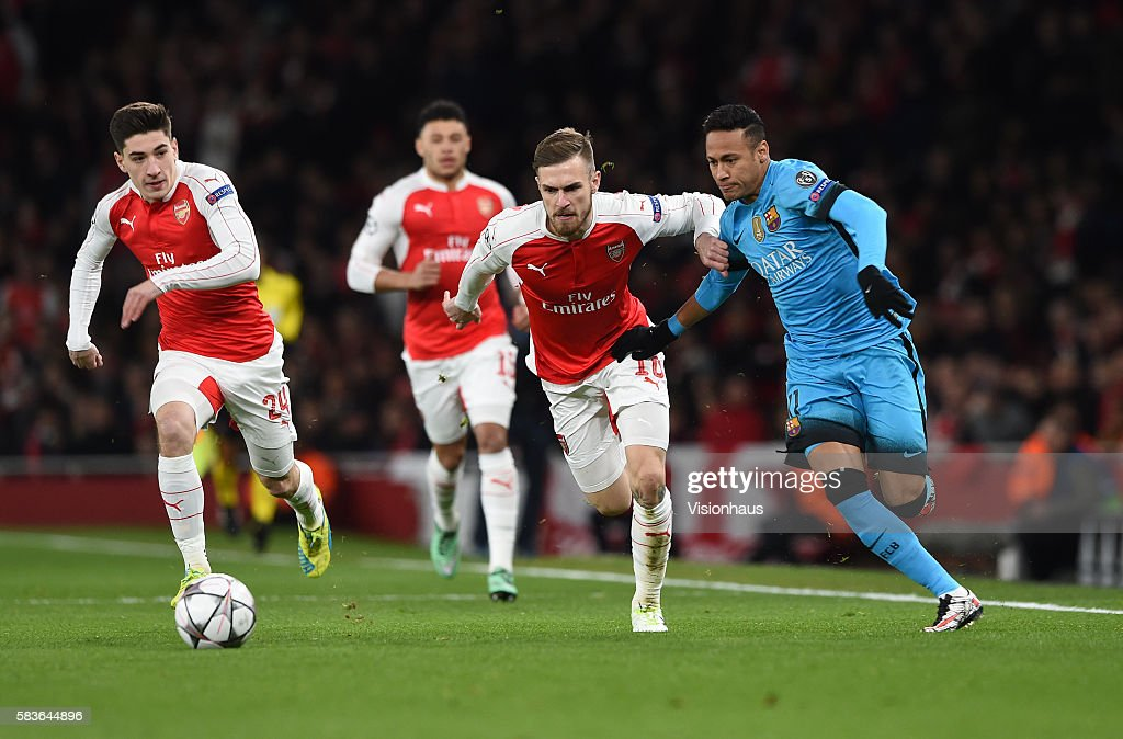 5cce216e16b Aaron Ramsey of Arsenal and Neymar Jnr. of Barcelona battle for the ...