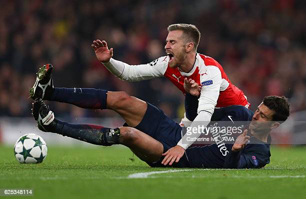 Aaron Ramsey of Arsenal and Thiago Motta of Paris St Germain during the UEFA Champions League match between Arsenal FC and Paris SaintGermain at...
