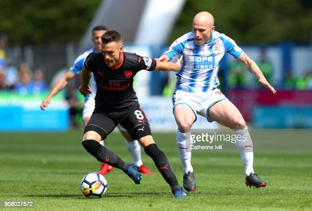 Aaron Ramsey of Arsenal battles for possession with Aaron Mooy of Huddersfield Town during the Premier League match between Huddersfield Town and...