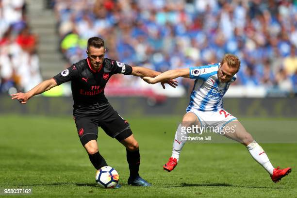 Aaron Ramsey of Arsenal battles for possession with Alex Pritchard of Huddersfield Town during the Premier League match between Huddersfield Town and...