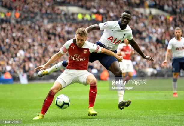 Aaron Ramsey of Arsenal battles for possession with Davinson Sanchez of Tottenham Hotspur during the Premier League match between Tottenham Hotspur...