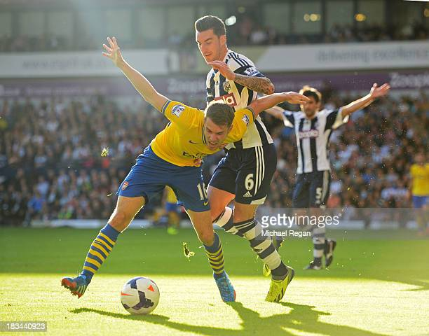 Aaron Ramsey of Arsenal battles with Liam Ridgewell of West Bromwich Albion during the Barclays Premier League match between West Bromwich Albion and...