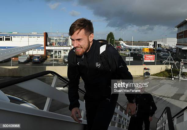 Aaron Ramsey of Arsenal boards the team flight to Athens at Luton Airport on December 8 2015 in Luton England Photo by Stuart MacFarlane/Arsenal FC...