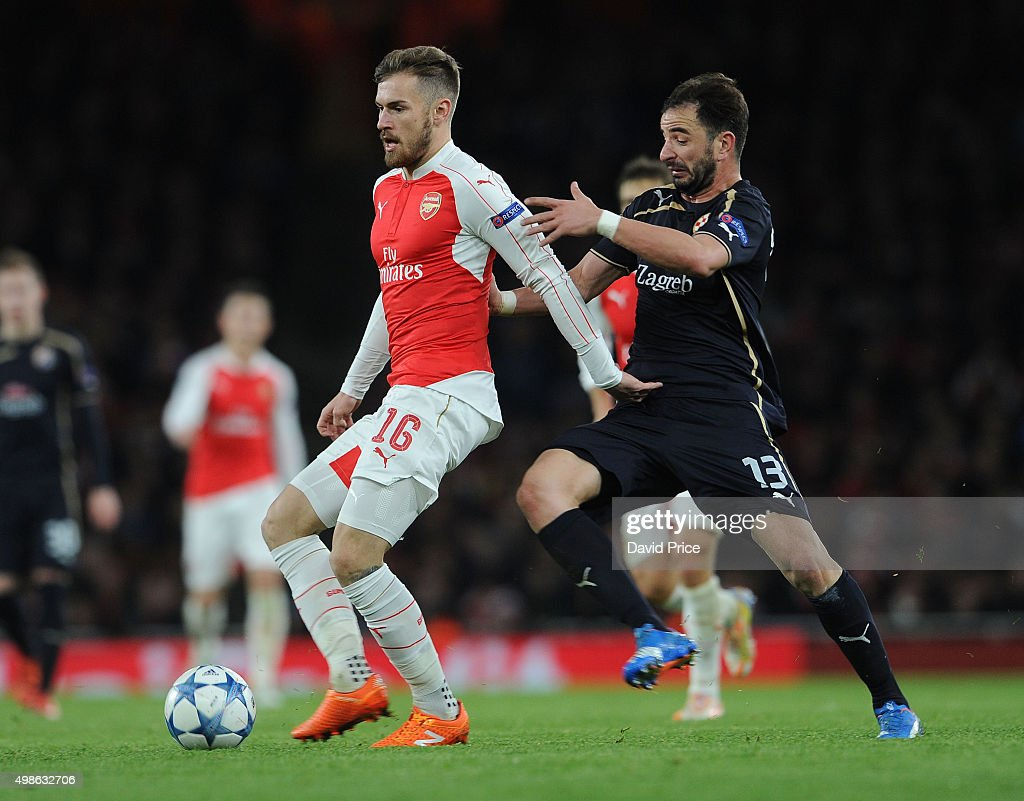 Aaron Ramsey of Arsenal breaks away from Goncalo Santos of Zagreb during the match between Arsenal and Dinamo Zagreb in the UEFA Champions League on November 24, 2015 in London, United Kingdom.