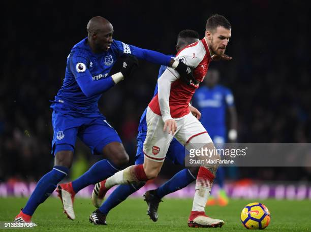 Aaron Ramsey of Arsenal breaks past Eliaquim Mangala of Everton during the Premier League match between Arsenal and Everton at Emirates Stadium on...