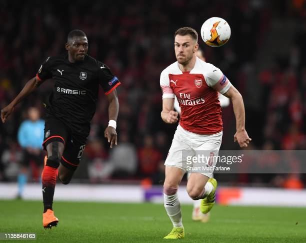 Aaron Ramsey of Arsenal breaks past Hamari Traore of Rennes during the UEFA Europa League Round of 16 Second Leg match between Arsenal and Stade...