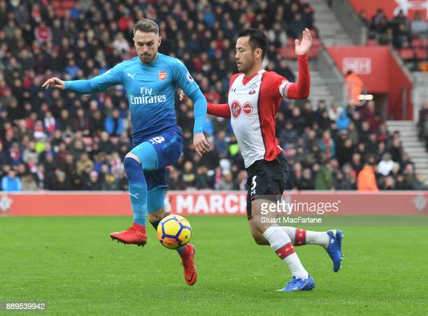 Aaron Ramsey of Arsenal breaks past Maya Yoshida of Southampton during the Premier League match between Southampton and Arsenal at St Mary's Stadium...