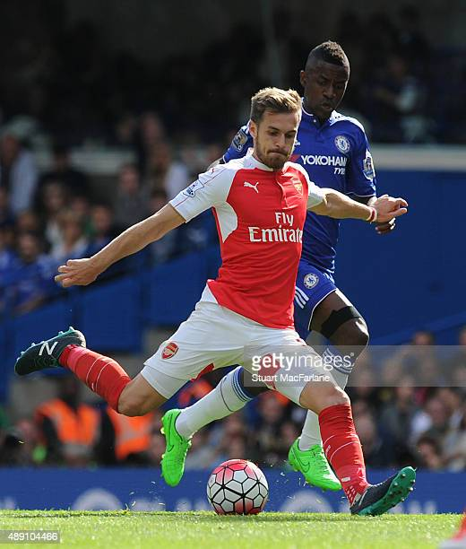 Aaron Ramsey of Arsenal breaks past Ramires of Chelsea during the Barclays Premier League match between Chelsea and Arsenal on September 19 2015 in...
